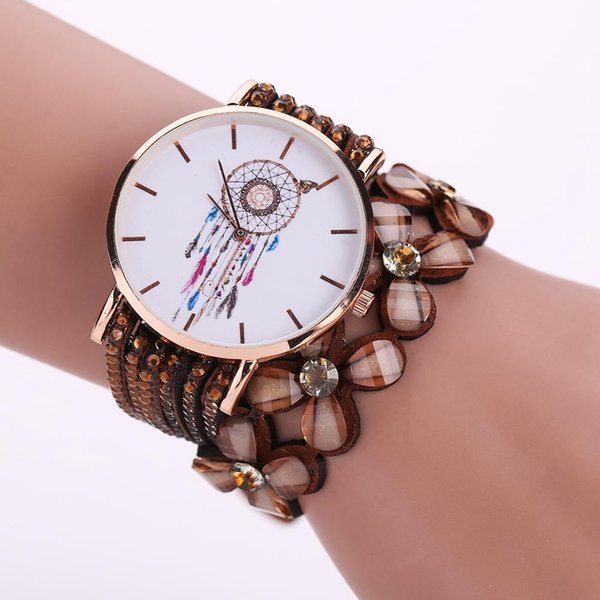 The velvet watch is wrapped around the lady's wrist bracelet in a vintage four-leaf clover crystal lady's wrist bracelet