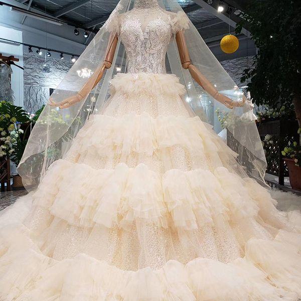 2019 Latest Lebanon High Neck Wedding Dresses Long Lace Veil Cascading Ruffles Tiered Skirts Feather Short Sleeve Garden Bridal Gowns
