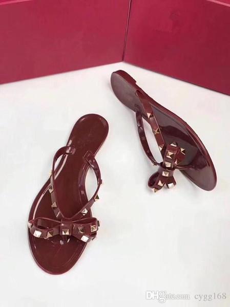 Женщины Заклепки Бантом Плоские Тапочки Девушки Шлепанцы Летняя Обувь Прохладный Пляж Желе Обувь размер 37 Бесплатная Доставка