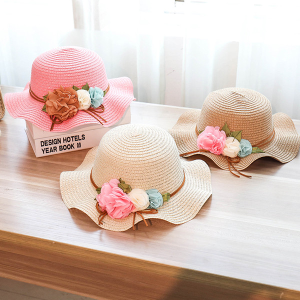 f49639bc Designer Straw Hats Ladies Wave Brimmed Beach Visors With Handmade Flower  Garland Foldable For Women UA