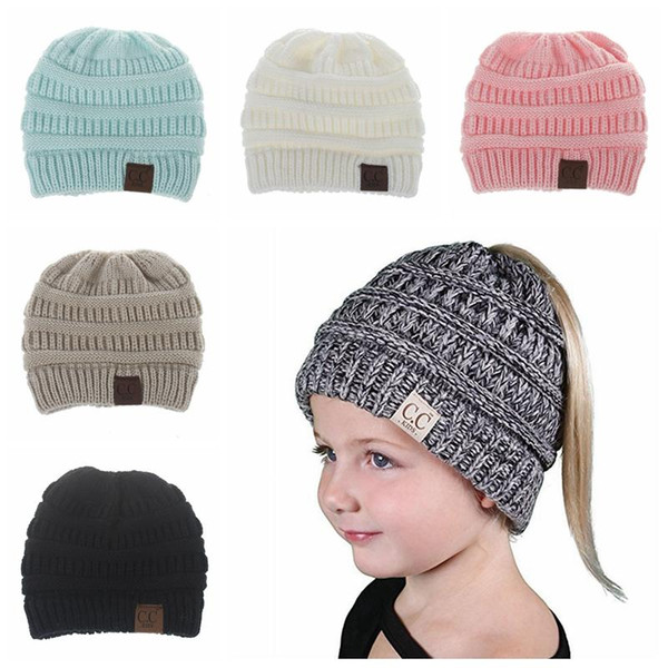 bd1cc1e2eba 6 Colors Children s CC Ponytail Messy Bun Beanie Solid Hat Soft Stretch  Cable Knit Messy High
