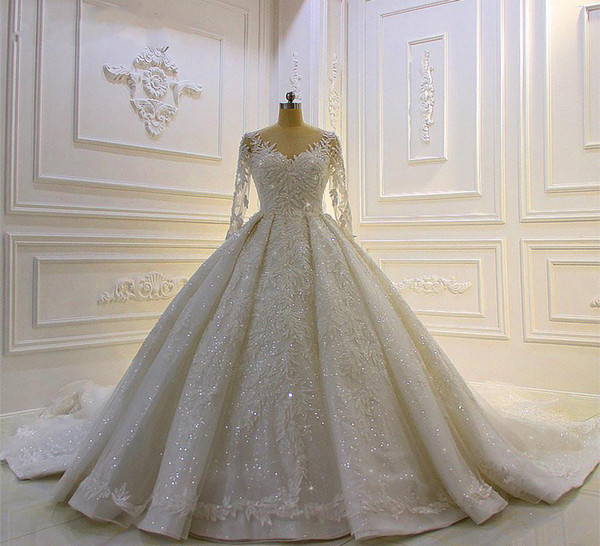 top popular Modest Long Sleeve Ball Gown Wedding Dresses Bridal Gowns Sheer Jewel Neck Lace Appliqued Sequins Plus Size Robe De Mariee Custom Made 2021