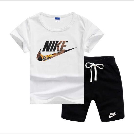 NlKELogo de lujo de niños Ropa para Niños verano cortocircuitos del juego del deporte del bebé pantalones de los niños de manga corta T ropa de la camisa de algodón Conjuntos
