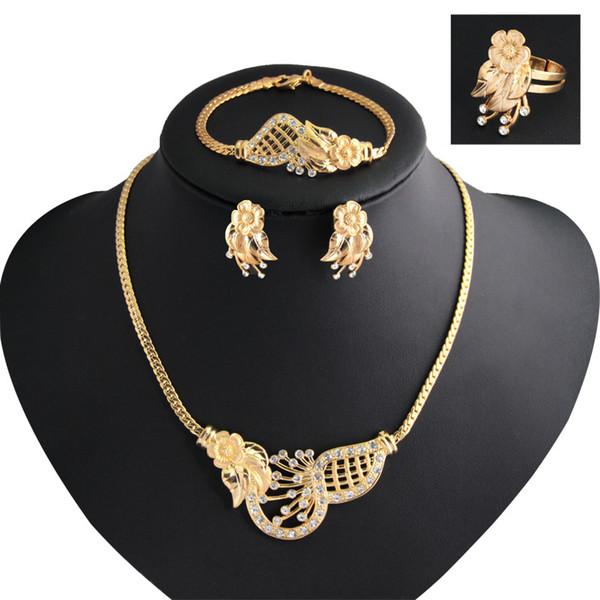 Orecchini da sposa europei e americani in oro con gioielli, collane, anelli, bracciali, catene a clavicola retrò, set di quattro pezzi all'ingrosso