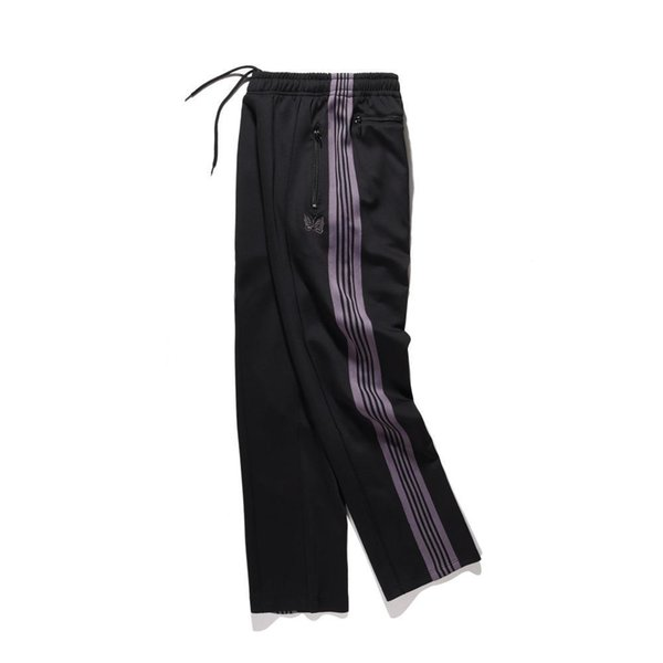 El diseñador japonés bordado de la mariposa Pantalones deportivos Hiphop púrpura raya Holgado pantalón envío