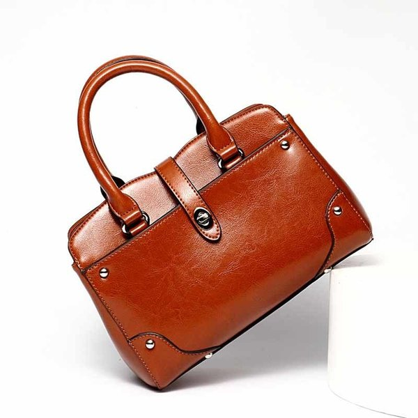 Fashion Trend Women's Solid Color Split Leather Handbag Elegant And Exquisite Multi-functional Noble Atmosphere Shopping Handbag