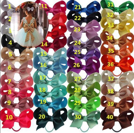 Nuevo 3 pulgadas 40 colorido niños niñas cinta del arco del arco de goma elástica con Rhinestone de dibujos animados Boutique pelo accesorios 20 unids