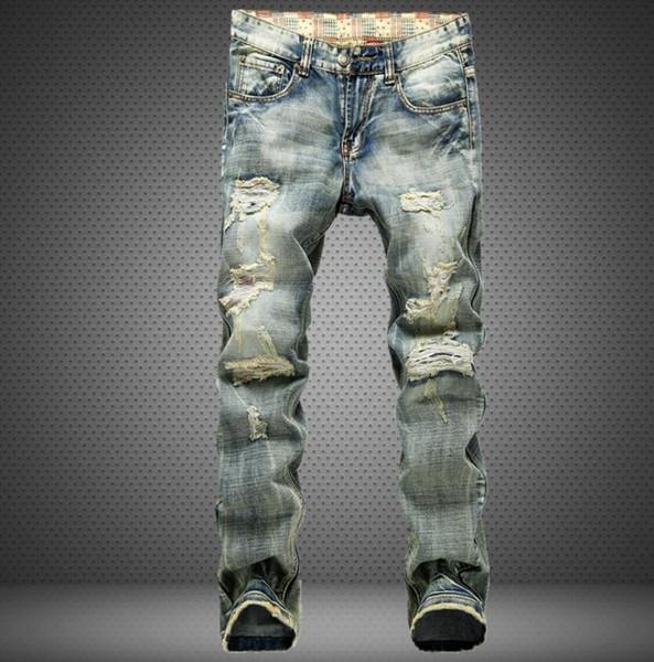 El agujero recto aplastado de los hombres versión europea de la marea masculina nostálgico desgastado jeans para hombres
