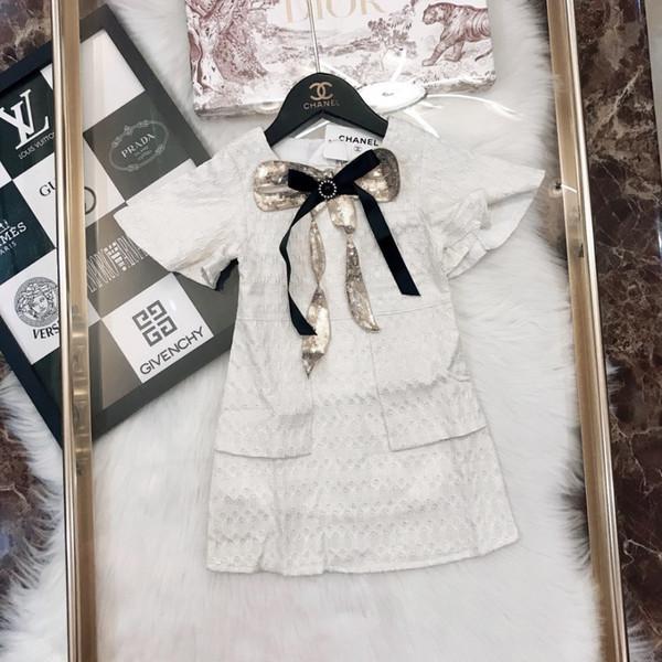 Ropa de diseñador para niños otoño nuevo vestido de las niñas con lentejuelas broche de diseño vestido material de fibra de poliéster