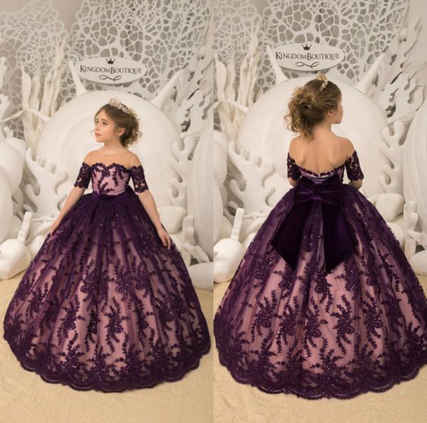L'uva della ragazza di fiore veste i sequins del pizzo della manica corta con le ragazze dell'abito del grande arco I bambini primi abiti da comunione per la festa nuziale