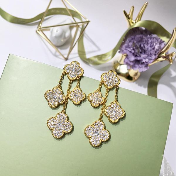 2019 exquisito trébol de cuatro hojas chapado en cobre aretes de diamantes con cuatro flores pendientes de diamantes para mujer pendientes de oro