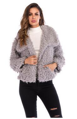 Col roulé en hiver en peluche de couleur pure chemisier femme lâche nouvelle veste européenne de mode de chaleur de chaleur à manches longues