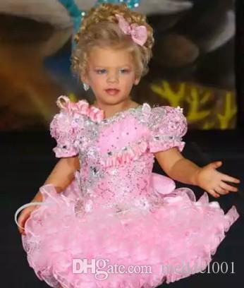 2020 Pink Ruffles Organza Girls Vestidos del desfile Rhinestones con cuentas Mini vestidos cortos para niñas de flores Vestidos de primera comunión