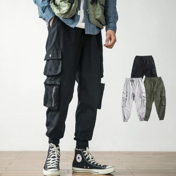 Hip Hop Designer Calças Soltas para Homens Estilo Ins Tide Marca dos homens Calça Casual com Muitos Bolsos Harlan Estilo Calças Macacões Tamanho M-4XL