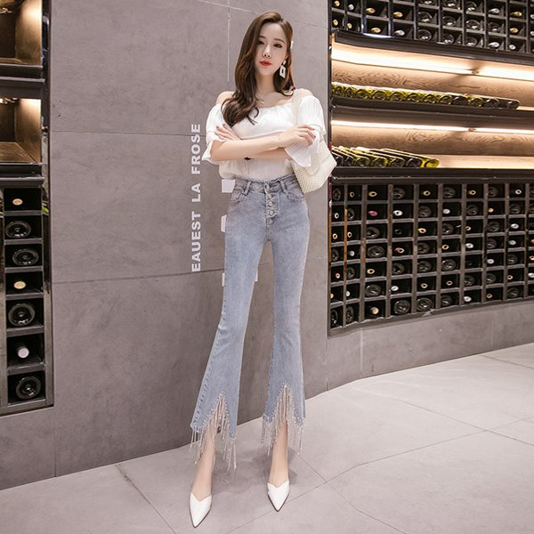 2019 women's jeans with diamond chain tassel irregular raw edge micro-horn stretch fashion cotton ankle length trousers a30