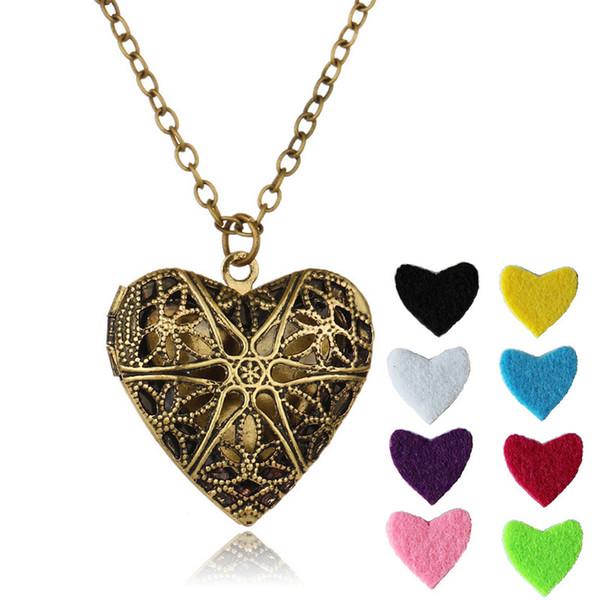 Colgante del corazón Collar de aromaterapia Joyas de moda Hollow Charms Collares con 8 piezas de color Rellenar almohadillas y 23.62