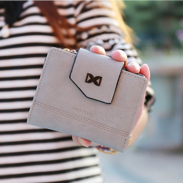 Amazon short lady wallet, Korean embossed small wallet eighty percent off zipper buckle Student Wallet