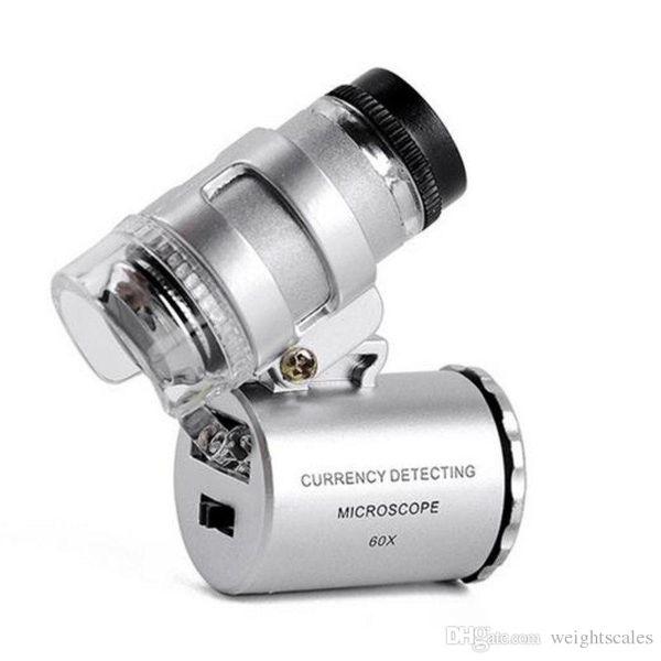360pcs / CTN 60x Mini microscopio de bolsillo portátil Lupa Joyero Lupa LED Luz fácil de llevar con una lupa a660