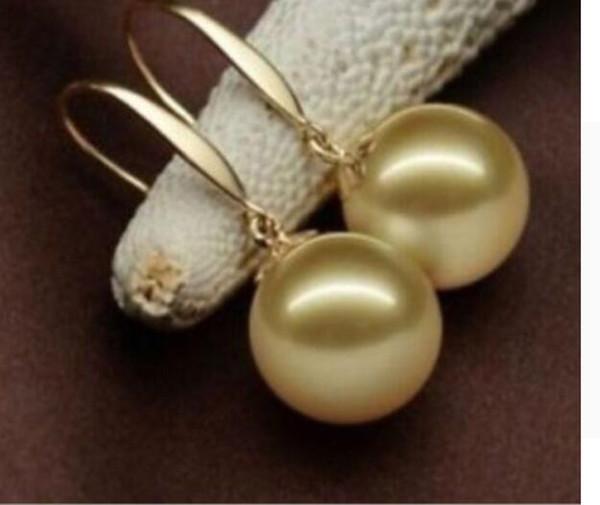 ENVÍO GRATIS + 6-20mm pendientes de perlas de concha dorada fuera del mar