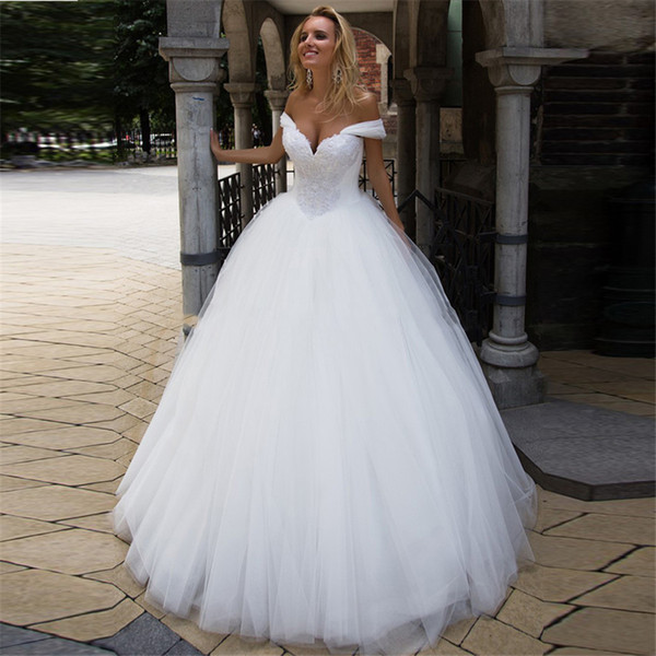 top popular 2020 Sheer Tulle Ball Gown Wedding Dresses Appliques Lace Bridal Gowns Modest Customized Robe De Mariage Plus Size 2021