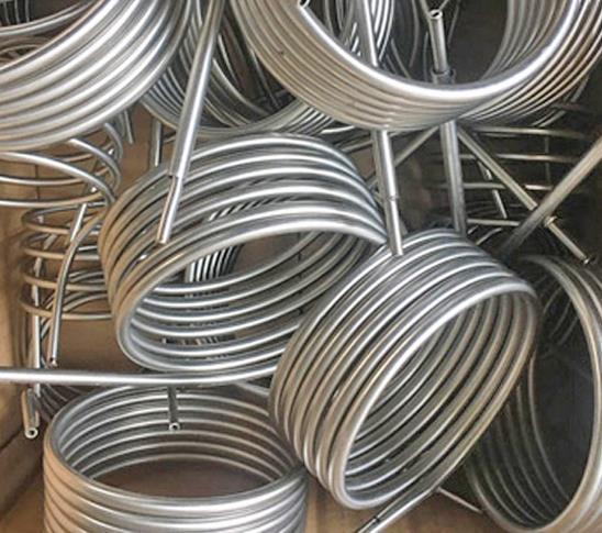 Tubo serpentino di raffreddamento in titanio Gr2 OD89.0mm per tubo di serpentino in titanio ASTM B338 Gr2 Bend per industria galvanica per piscina
