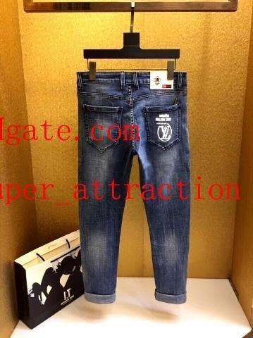 Die Kleidung der Männer beunruhigte zerrissene dünne Jeans-Art und Weisemarke dünnes Motorrad Moto Radfahrer-verursachendes Mens-Denim keucht das jeans7 der Hip Hop-Männer