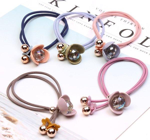 HB060 Nuevo accesorio para el cabello flor de cristal cuerda para el cabello moda cabeza cuerda 20 piezas / bolsa los productos de color se envían aleatoriamente
