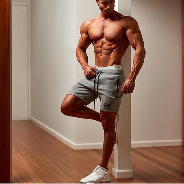 Pantalones cortos de algodón para hombre Corre trotar deportes Fitness culturismo Pantalones deportivos para hombre entrenamiento de entrenamiento Marca pantalones cortos