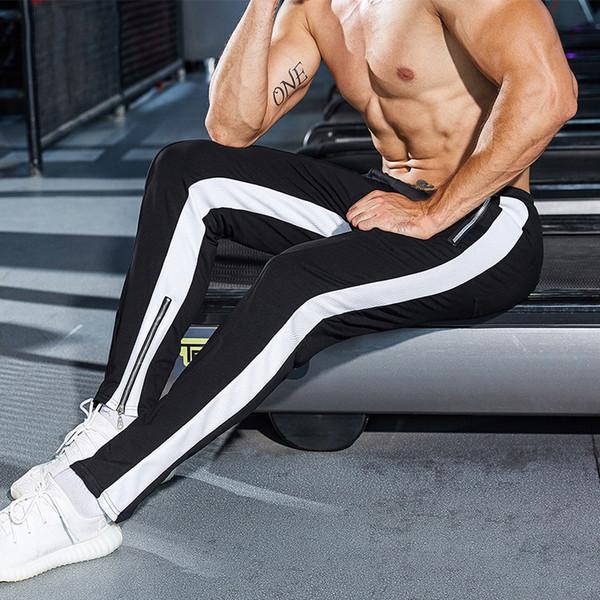 Mens GYM Pantalon Printemps Noir Blanc Rayé Long Crayon Pantalon Zipper Designer Sports Athlétique Fitness Jogger Pantalon