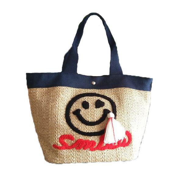 Korean Version Of The 2019 New Ladies Straw Bag Cartoon Cute Smile Tassel Pendant Beach Literary Women's Bucket Handbag Big
