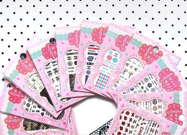10pcs décalcomanie sur l'eau transfert de la marque logo nail art rose conçoit des autocollants mixtes decal