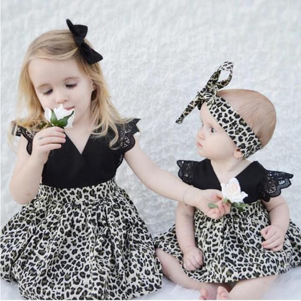 Vestido del mameluco del estampado floral del leopardo de los bebés del verano + diadema del bowknot 2pcs / set pequeñas hermanas juego a juego