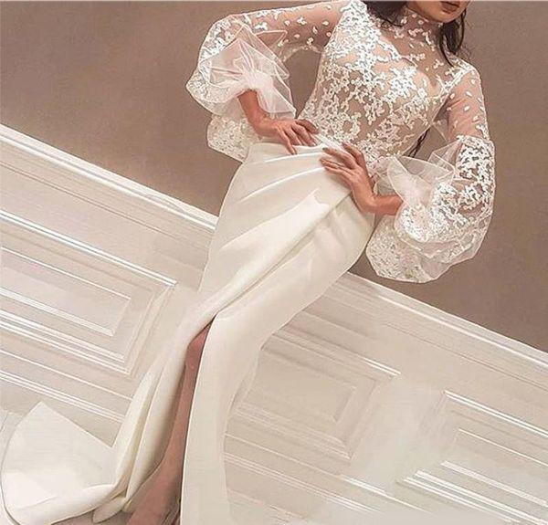 2019 Más nuevo Cuello alto Blanco Árabe Vestidos de noche Longitud del piso Apliques de encaje Manga larga y grande Sirena Corte lateral Vestidos de baile