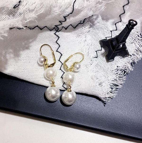 Pendientes de perlas redondas de talla barroca, la hembra era de temperamento delgado, pendientes largos, red, pendientes rojos