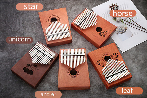 top popular C003 High quality 17 Keys Kalimba Wood Mahogany Body Thumb Piano Musical Instrument accessories colors can be choosed 2021