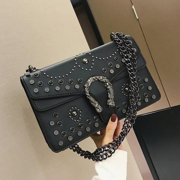 Factory wholesale brand women handbag personalized rivet punk bag ins super fire diamond chain bag flip snake lock shoulder bag