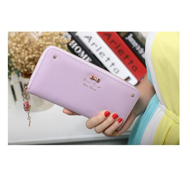 Fashion women's wallet cross pattern bow lady long zipper wallet clutch bag handbag