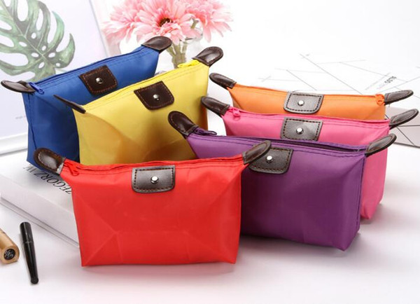 top popular Top Quality Lady MakeUp Pouch Waterproof Cosmetic Bag Clutch Toiletries Travel Kit Casual Small Purse Candy Sport 10 Colors 2019 2021