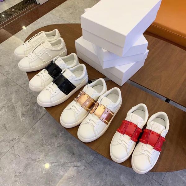 Últimos remaches de cuero Pisos, metal Spike zapatillas de cuero para mujeres hombres Casual Patchwork moda Casual zapatos casuales tachonado tamaño 35-44
