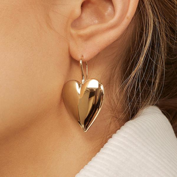 Retro einfache europäische und amerikanische Ohrringe Neue übertriebene Liebesohrringe schwarzes Golddamenstraßenschießenart und weisepunkwindohrringe femal