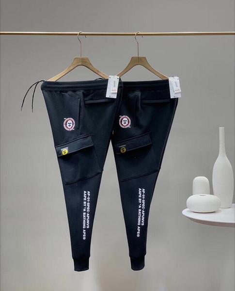 20/aape fashion mens cargo pants European designer classic Ape head logo boutique mens sweatpants street hip-hop trend men black pants wild