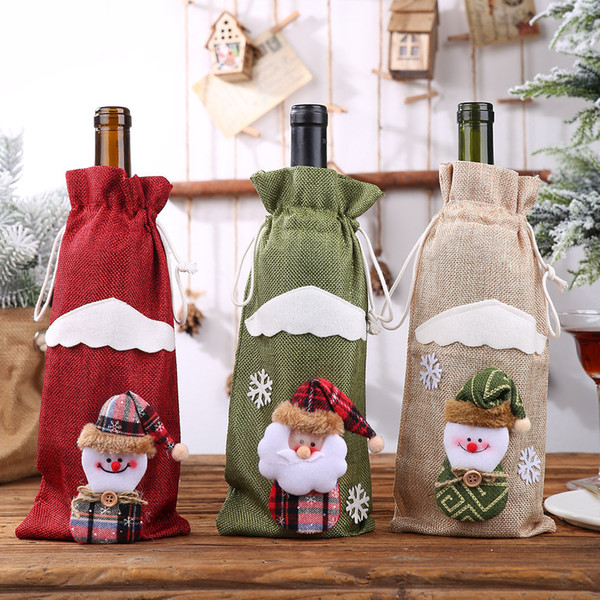 top popular 2020 Christmas Wine Bottle Decor Set Santa Claus Snowman Deer Bottle Cover Clothes Kitchen Decoration 3 Colors 2019