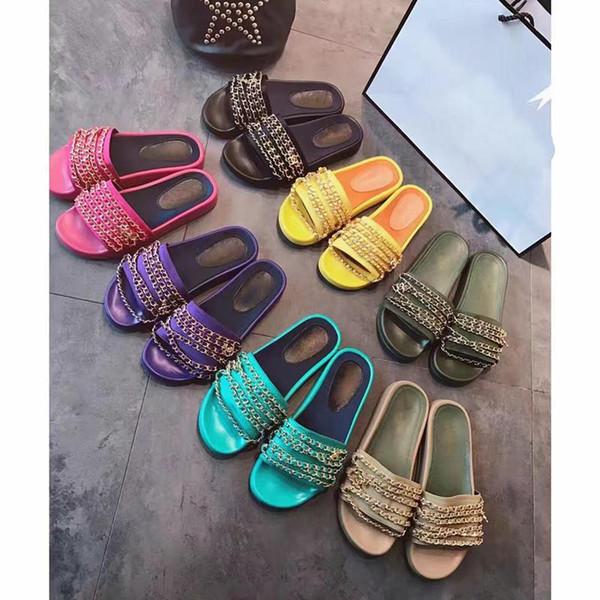 Diseñador de lujo para mujer sandalias planas de cadena deslizante al aire libre playa moda causal zapatillas planas de goma con caja