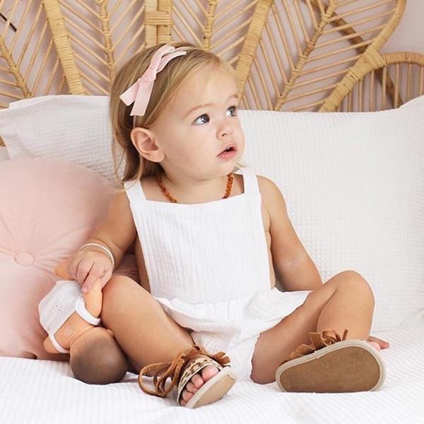 Pure White Baby Girls Sleeveless Rompers Dresses New Arrival Newborn Girls Bodysuits One-piece Sleeveless Belt Blackless Girls Jumpsuit