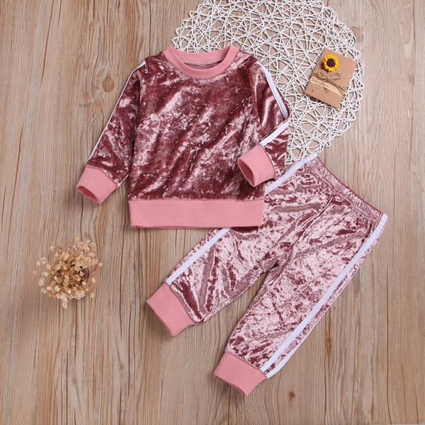 I vestiti della ragazza dei bambini regolano le parti superiori a manica lunga e i pantaloni vestiti casuali di sport degli abiti sportivi di autunno