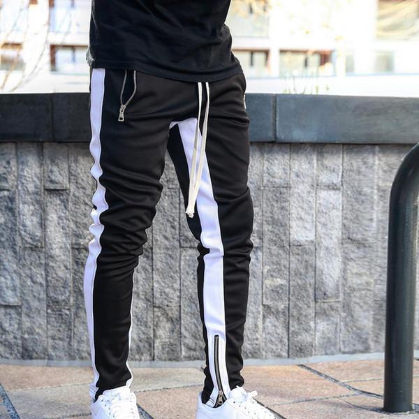 top popular Mens Joggers Casual Pants Fitness Men Sportswear Tracksuit Bottoms Skinny Sweatpants Trousers Black Gyms Jogger Track Pants 2020