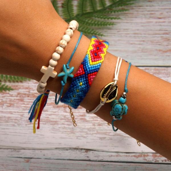 Pulseras de concha de raso arcoiris tejidas a mano Conjunto de pulsera de conchas Estrella de mar Tortuga Cruz Boho Weave Colorido Multi-capa Brazalete Mujer