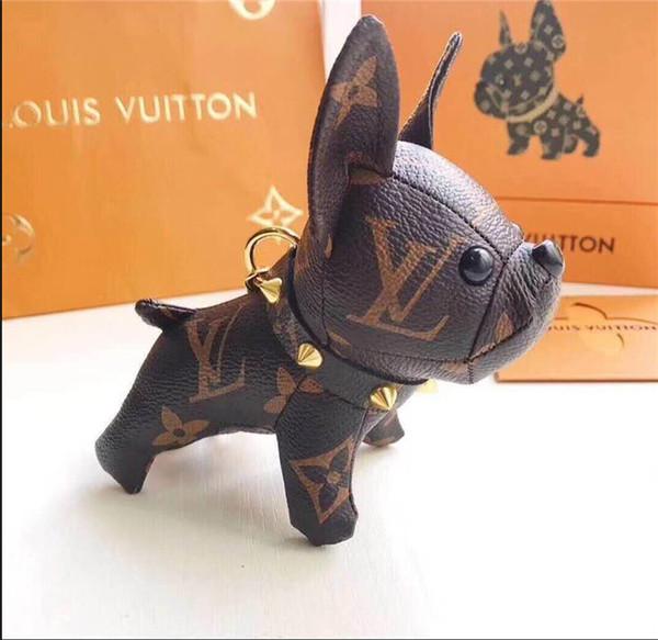 Mode luxe porte-clés nouvelle européenne et américaine de la peau de vache chien clé pendentif sac voiture pendentif cadeau boîte emballage en gros A000001