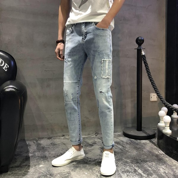2019 spring light color hole long jeans male elastic Slim feet tide male tide harem pants trend trousers