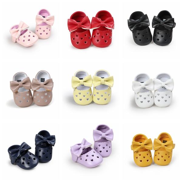 Zapatos para bebés recién nacidos Princesa Mary Jane Arco grande Hueco Cuna en forma de corazón Primeros andadores Cuna Calzado Prewalkers
